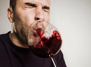 It turns out you can turn your vomit blood red by drinking enough of any alcohol.