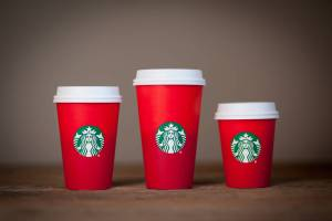 Starbucks picked the perfect symbol to capture the 2015 holiday spirit: an angry red cup that runneth over with hot, scalding rage because the barista didn't leave room for cream.