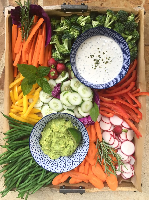 vegetable tray for a party with homemade ranch and avocado dip