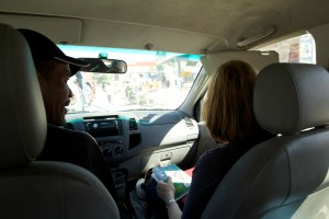 Dr. McGrath gets creole lessons from our driver on our way out of Port au Prince.
