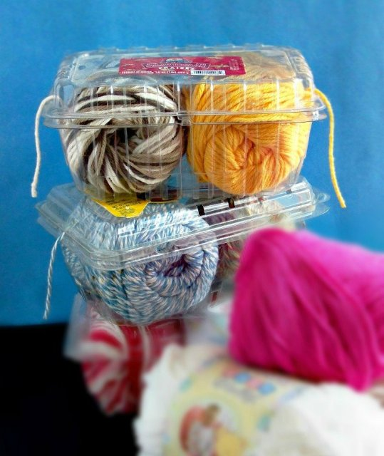 Plastic container twine holder at sewlicioushomedecor.com  DIY Toilet Paper Roll Yarn Holders