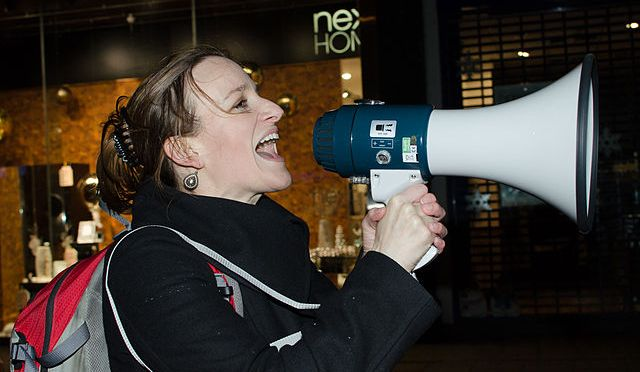 Kate Smurthwaite leads the chants at the Reclaim The Night march, London, UK, 2011 (photo: Charlotte Barnes via Wiki Commons)