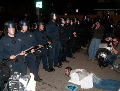OG Mehserle sentencing cops face protester in I-am-Oscar-Grant position 110510 by Felix Barrett