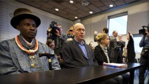 Friends of the Earth campaign leader Geert Ritsema, Nigerian farmer plaintiff Eric Dooh await ruling against Shell Niger
