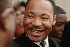 Martin Luther King smiles w church family at news he won Nobel Peace Prize 110864 by Flip Schulke, Corbis