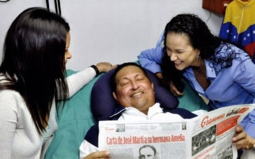 Hugo Chavez, daughters in Cuba hospital reading Granma 021413-2 by Prensa Presidencial