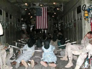 POWs, bags on heads, fly to Guantanamo