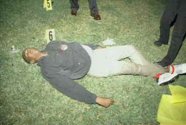 Trayvon Martin lying dead on grass 022612, death photos released 062713