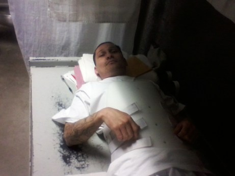 Juan Jaimes w broken back in brace on bare bed 072312 pic emailed to Kendra, web