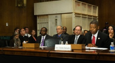 Panel w Dir. of FBOP Charles Samuels Jr. at mic, mock solitary cell by ACLU at Senate hearing 061912 by Jonathan Ernst, NYT