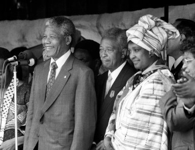 Nelson, Winnie Mandela, Mayor David Dinkins at Boys and Girls High School Brooklyn 1990 by Fred R. Conrad, NYT