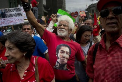 Venezuela pro-gov peace march by elders Simon Bolivar T-shirt 022314 by Rodrigo Abd, AP