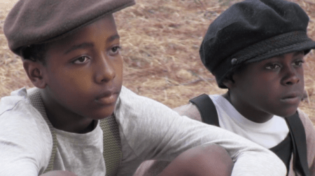 Akili Moree as the young Oscar and Jordan Stewart as Swan Micheaux