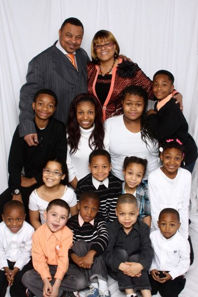 Dr. Willie Ratcliff's son, Elder Glenn Ratcliff, pastor of Calvary Community Church of God in Christ in Anchorage, Alaska, with First Lady Linda Jewel Ratcliff, embrace just a portion of their family in Anchorage: Isaiah, Neci, Mya and Davin in the next to back row; Jaden, Evan, Lila and Natalie; and Christopher, Cameron, Ethan, Glenn III and Nick E Poo in the front row. Both of Dr. Ratcliff's other sons who live in the Anchorage area, Lafone and Stanley Ratcliff, are deacons in the church and proudly head large families of their own. They all ask you and your church family to join them in helping  and praying for little Nick's survival.