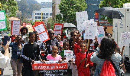 Parents and Children of African Descent (PCAD), led by Berkeley students, march down University Avenue on Malcolm X Day, a school holiday in Berkeley, demanding equity to close the large achievement gap for Black students. – Photo: Laura Savage