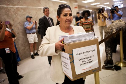 Dolores Canales, founder of California Families Against Solitary Confinement, delivers 60,000 signatures (an additional 19,000 had been gathered after the sign saying 41,000 was made) protesting perpetual solitary confinement to Gov. Brown's office on July 30, 2013. She and Marie Levin behind her – both with loved ones in solitary for decades – have emerged as leading advocates in the struggle to end torturous solitary confinement and have inspired hundreds of other prisoners' family members to speak out at rallies and at legislative hearings.