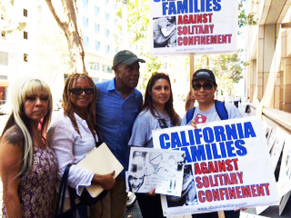 Lending some celebrity to the LA rally are KPFK Radio host Margaret Prescod and Danny Glover (second and third from left).