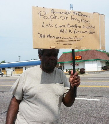 This man's sign speaks for the people of Ferguson – the wisdom of the elders transformed by the youth into action. This is one of the first photos taken by Bay View associate editor and Minister of Information JR Valrey when he landed Thursday evening in St. Louis and went straight to Ferguson. His photos illustrate much of what his long time comrade, Rodrigo Starz of Rebel Diaz, who was already there, discovered in this story. – Photo: JR Valrey, Block Report