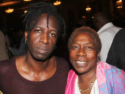 "Afeni Shakur honored her son on his birthday by taking friends and family to see ""Holler If Ya Hear Me."" They took pictures with the cast. This is Afeni with Saul Williams, who stars in the role of John. – Photo: Bruce Glikas, Broadway.com"