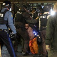 A man is arrested by police after kneeling in the street during a protest outside the Ferguson Police Department on Saturday, Nov. 29. – Photo: Jeff Roberson, AP