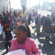 The Deecolonize and POOR family marched with thousands through the streets of San Francisco on Martin Luther King Day. That's 9-year-old Queena in front dressed in pink. – Photo: Poor News Network