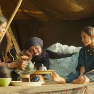 "Satima (Toulou Kiki), her husband, Kidane (Ibrahim Ahmed aka Pino), and child, Toya (Layla Walet Mohamed), in ""Timbuktu"""