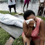 On Aug. 30, 2005, one day after Katrina flooded the 9th Ward, a woman who herself may have been in mortal danger mourns the death of a loved one.