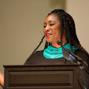 "Eight hundred people filled Harvard's Memorial Church on Oct. 30, 2015, when Alicia Garza, Oakland-based co-founder of the Black Lives Matter network, was the honoree of the ninth annual Robert Coles ""Call of Service"" Lecture and Award. She began by dedicating the award to the BLM network and the people ""still fighting for humanity and dignity."" When she coined the phrase Black Lives Matter in 2013, she called it ""a love letter to our people"" and ""a call to action."" – Photo: Jon Chase, Harvard staff photographer"
