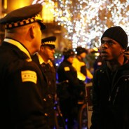 Amid complaints from police that they're being intimidated, Chicago youth, one on one, show they are not afraid during Nov. 24 protests over the dashcam video of Officer Van Dyke's murder of Laquan McDonald. – Photo: Chicago Tribune