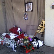 The altar built as a memorial to Mario Woods is in disarray here, but it's tended daily by people who live nearby or who come to pay their respects. The candles are upside down to keep the wicks dry. – Photo: Rochelle Metcalfe