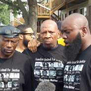In Ferguson, Missouri, on Aug. 9, 2015, Oscar Grant's Uncle Bobby, Brother Shahid and Michael Brown Sr. support each other on the one year anniversary of the police murder of Michael Brown Jr.