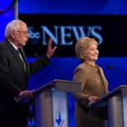 Sen. Bernie Sanders speaks as former Secretary of State Hillary Clinton smiles during an ABC News debate in December. – Photo: Disney, ABC