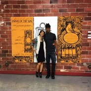 "Martha Alhassen, journalist and PhD candidate at USC, and Greg Thomas, curator and Tufts University professor, embrace after the roundtable discussion in front of ""Sun"" artwork. – Photo: Omar Ali"