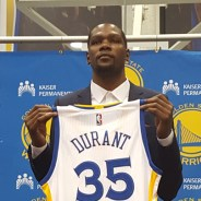 Lee Hubbard, right, is one of the reporters talking with Kevin Durant in this frame from KTVU's coverage of the introductory press conference.