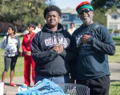 Baba Jahahara greets a comrade at the SF Bay View table on Sunday. Baba Jahahara and Billy X Jennings made sure the Bay View was available everywhere during the celebration. – Photo: Malaika Kambon