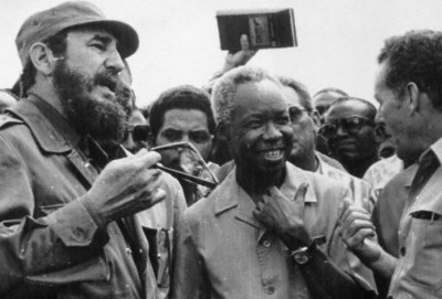 Fidel Castro and Julius Nyerere talk with a Cuban worker in 1977. – Photo courtesy Julius Nyerere Archives