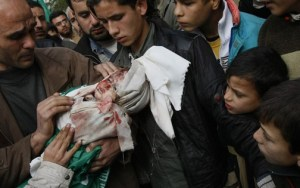 Life and death in Gaza, January 2009: Palestinian mourners carry the body of one of Hamas leader Nizar Rayanï's slain children during a funeral procession in Jabalia on the way to the Beit Lahia cemetery in the northern Gaza Strip on Jan. 2, 2009, after he was killed in an Israeli air strike that also killed his father and other members of his family. - Photo: Mamud Hams, AFP Getty Images