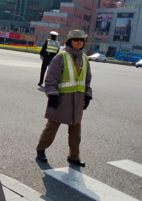 The Chinese are a very happy people, but no so much the crossing guards.  Not sure why, but they really take their job seriously and yell at anyone that doesn't strictly follow their instructions.