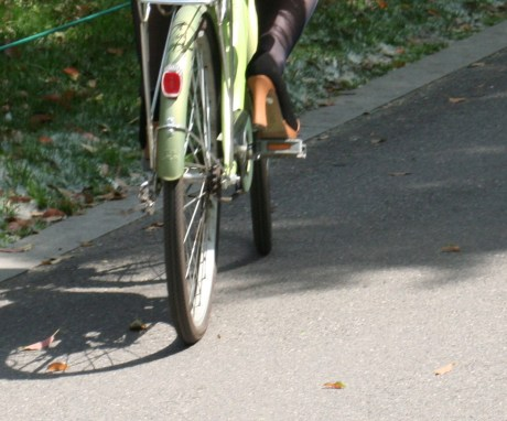 The Chinese women have a thing for their heels and they wear them just about everywhere.  I even saw one woman run across the lawn at the Microsoft office with stilettos on so she could play Frisbee.  And this woman wanted to ride her bike in heels.  No wonder the Chinese are so good at gymnastics...