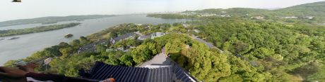 I put up a Photosynth of this view, but not the panorama.  Of the places around Shanghai, Hangzhou was probably one of my favorite stops.  This is from the top of Leifung Tower.
