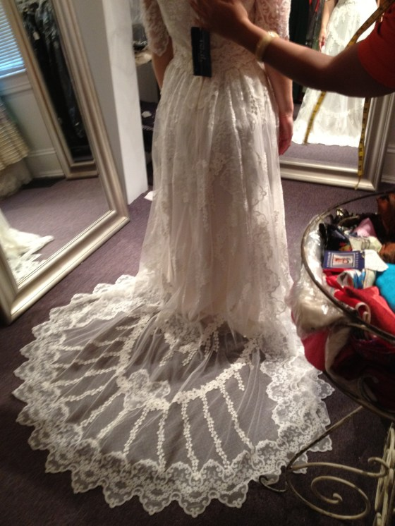 This vintage wedding dress was in a shop just outside of Washington, DC. Rachael didn't find her dress here, but had fun trying some on. We didn't want to take a full view because we don't want Jonathan seeing her in any wedding dress until the big day!