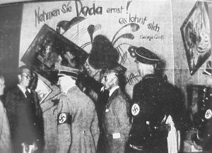 Hitler in front of a Dada artwork