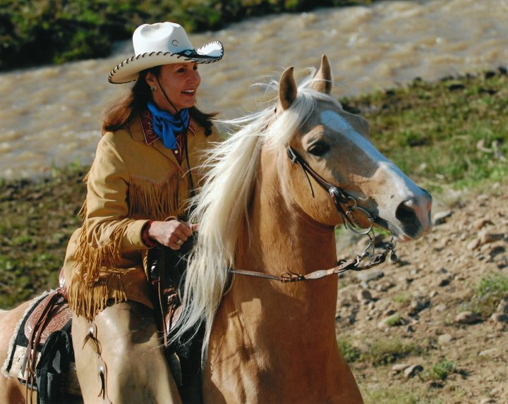My sweet mother riding her favorite horse, Dorado.  *Photographer unknown, my apologies.