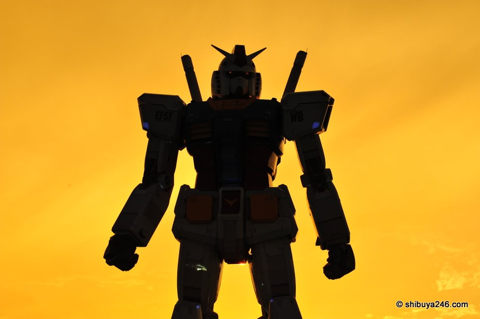 The sky turns a deep orange and Gundam's eyes flash red
