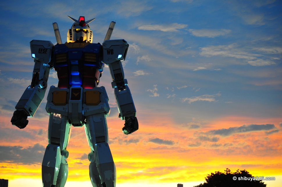 Towering above the buildings, the sky alone is on Gundam's eyeline