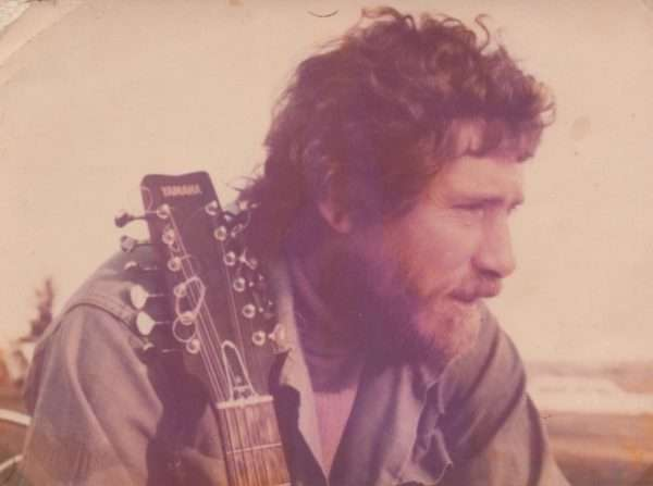My dad and his guitar. Around 1976.