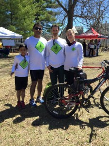 After the Rock to Rock Earth Day Ride on April 25, Shoreline Team members Farhan Soomro and his son Saami relax with Board member Glenn Gaffield and Anna Heinzel.