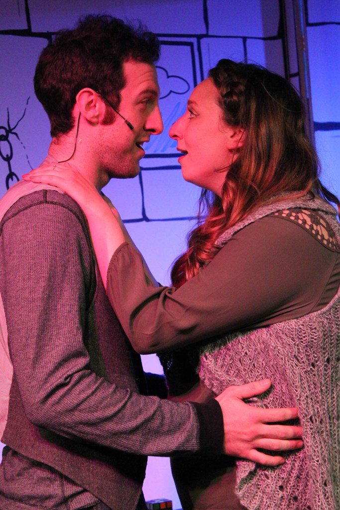 """""""Prison Love"""" (left to right) Max DeTogne and Lauren Paris in Underscore Theatre Company's world premiere musical comedy THE STORY OF A STORY (THE UNTOLD STORY) with book and lyrics by Peter Gwinn, music by Jody Shelton and direction and choreography by Christopher Pazdernik.  Photo by Alex Higgin-Houser."""