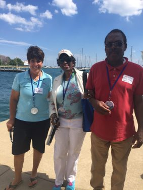 Nancy Berberian (wife of Chicago Yacht Club treasurer, Nick Berberian), participant from The Chicago Lighthouse, Roger Brown (The Chicago Lighthouse)