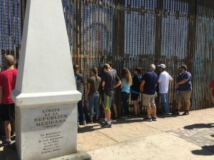 Ashley, fourth from the right in hoodie and shorts, on the Mexico side of the border.